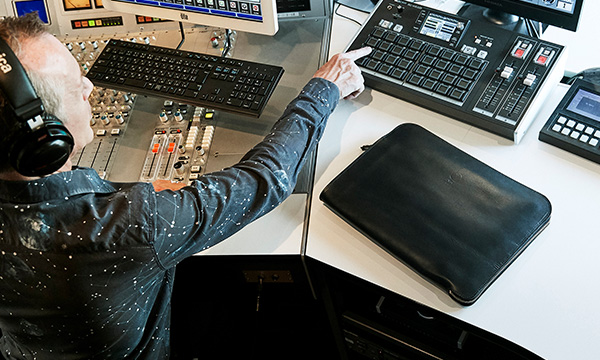 The perfect-sized clutch bag to hold the prized possessions of a radio DJ.